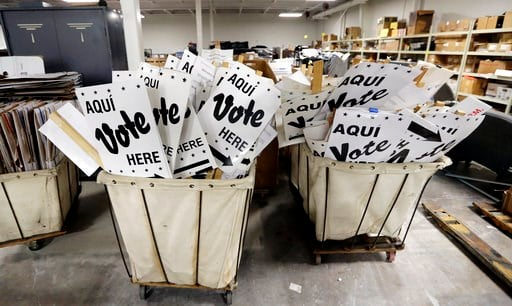 (AP Photo/Eric Gay, File). FILE - In this Feb. 13, 2018, file photo, bins of signs are seen in a storage are at the Bexar County Election offices in San Antonio. Texas kicks off primary season this ahead of the 2018 midterm election, with implications ...
