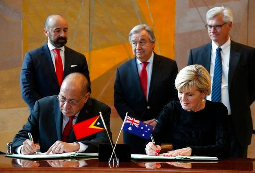 (AP Photo/Seth Wenig). East Timorese Minister of State Agio Pereira and Australian Foreign Minister Julie Bishop sign a treaty during a ceremony at United Nations headquarters, Tuesday, March 6, 2018. Australia and East Timor signed a treaty that draws...