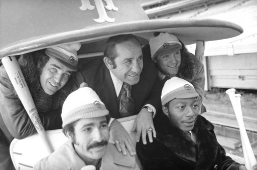 (AP Photo, File). FILE - In this January 1973 photo, New York Mets manager Yogi Berra, center, poses in the team cart at Shea Stadium in New York with four who signed with the baseball team earlier in the day. They are, back row and from left: Ed Krane...