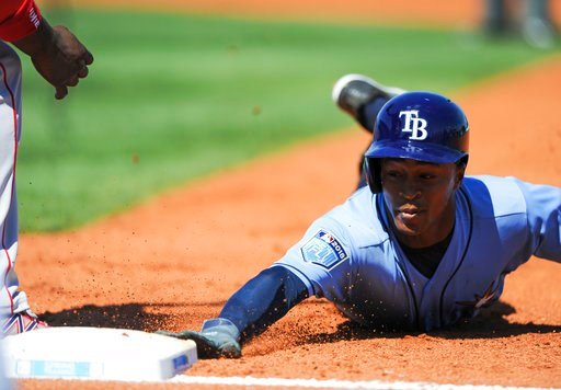(Chris Urso/The Tampa Bay Times via AP). Tampa Bay Rays' Mallex Smith (0) dives back to first base on a pick-off attempt by the Boston Red Sox during the third inning of a spring training baseball game Tuesday, March 6, 2018, in Port Charlotte, Fla. Bl...