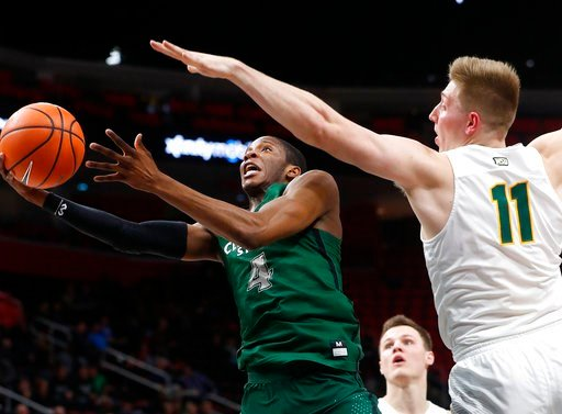 (AP Photo/Paul Sancya). Cleveland State's guard Kenny Carpenter (4) drives past Wright State's center Loudon Love (11) during the first half of an NCAA college basketball game for the championship in the Horizon League men's tournament in Detroit, Tues...