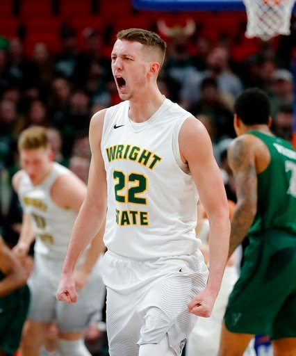 (AP Photo/Paul Sancya). Wright State center Parker Ernsthausen reacts to making a basket against the Cleveland State during the first half of an NCAA college basketball game for the championship in the Horizon League men's tournament in Detroit, Tuesda...