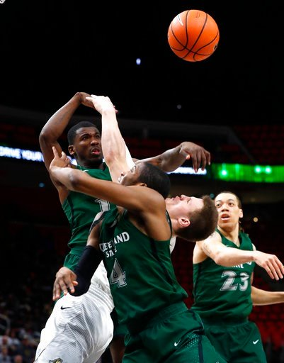 (AP Photo/Paul Sancya). Wright State's guard Grant Benzinger battles with Cleveland State's guard Terrell Hales, left, and Kenny Carpenter (4) for a loose ball during the second half of an NCAA college basketball game for the championship in the Horizo...