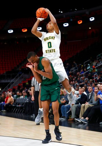 (AP Photo/Paul Sancya). Wright State's guard Jaylon Hall (0) shoots over Cleveland State's guard Bobby Word (20) during the second half of an NCAA college basketball game for the championship in the Horizon League men's tournament in Detroit, Tuesday, ...