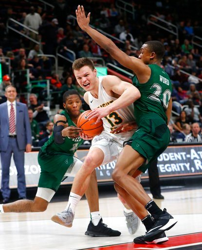 (AP Photo/Paul Sancya). Wright State's guard Grant Benzinger (13) drives on Cleveland State's guard Kenny Carpenter, left, and Bobby Word (20) during the second half of an NCAA college basketball game for the championship in the Horizon League men's to...