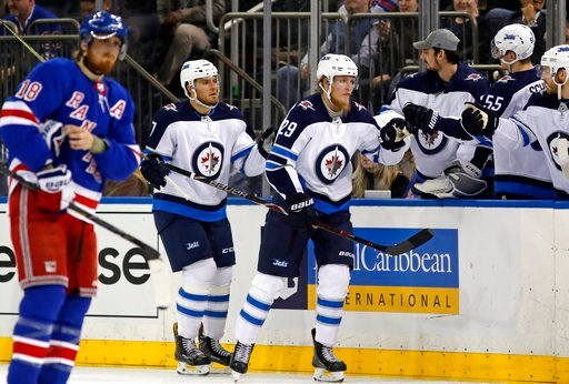 (AP Photo/Kathy Willens). Winnipeg Jets teammates greet Jets defenseman Ben Chiarot (7) and Jets right wing Patrik Laine (29) of Finland who scored his second goal during the second period of an NHL hockey game against the New York Rangers in New York,...