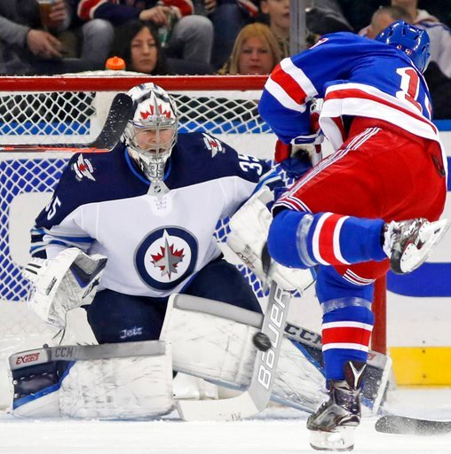 (AP Photo/Kathy Willens). New York Rangers right wing Jesper Fast (17) of Sweden takes a shot against Winnipeg Jets goaltender Steve Mason (35) during the first period of an NHL hockey game in New York, Tuesday, March 6, 2018.