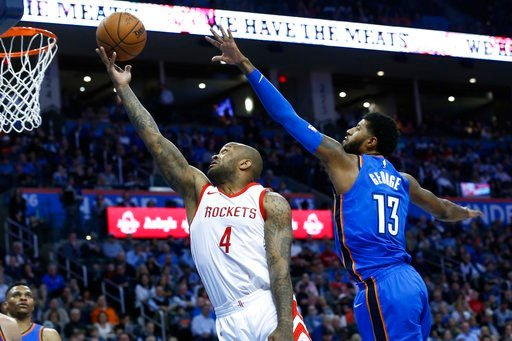 (AP Photo/Sue Ogrocki). Houston Rockets forward P.J. Tucker (4) shoots in front of Oklahoma City Thunder forward Paul George (13) in the first half of an NBA basketball game in Oklahoma City, Tuesday, March 6, 2018.
