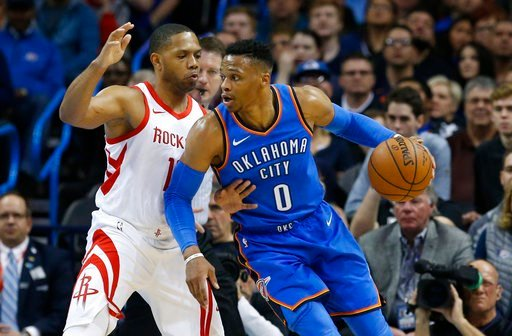(AP Photo/Sue Ogrocki). Oklahoma City Thunder guard Russell Westbrook (0) drives against Houston Rockets guard Eric Gordon, left, in the first half of an NBA basketball game in Oklahoma City, Tuesday, March 6, 2018.