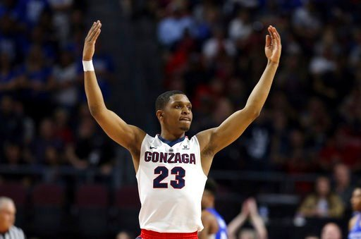 (AP Photo/Isaac Brekken). Gonzaga's Zach Norvell Jr. raises his hands to the crowd during the first half of the West Coast Conference tournament championship NCAA college basketball game against BYU Tuesday, March 6, 2018, in Las Vegas.