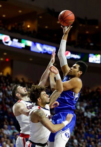 (AP Photo/Isaac Brekken). BYU's Yoeli Childs shoots over Gonzaga's Killian Tillie, left, and Josh Perkins during the first half of the West Coast Conference tournament championship NCAA college basketball game Tuesday, March 6, 2018, in Las Vegas.