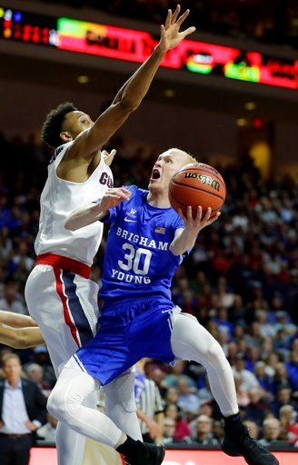 (AP Photo/Isaac Brekken). Gonzaga's Johnathan Williams covers a shot from BYU's TJ Haws during the first half of the West Coast Conference tournament championship NCAA college basketball game Tuesday, March 6, 2018, in Las Vegas.