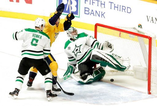 (AP Photo/Mark Humphrey). CORRECTS TO THIRD PERIOD NOT SECOND Nashville Predators' Colton Sissons, center, celebrates a goal by teammate Ryan Hartman against Dallas Stars goalie Kari Lehtonen (32), of Finland, in the third period of an NHL hockey game ...