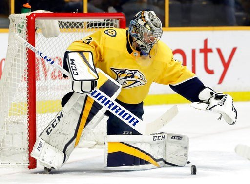 (AP Photo/Mark Humphrey). Nashville Predators goalie Pekka Rinne, of Finland, blocks a shot against the Dallas Stars in the first period of an NHL hockey game Tuesday, March 6, 2018, in Nashville, Tenn.