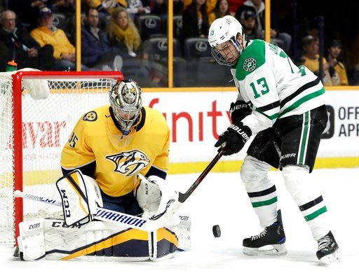 (AP Photo/Mark Humphrey). Dallas Stars center Mattias Janmark (13), of Sweden, reaches for the rebound after Nashville Predators goalie Pekka Rinne (35), of Finland, blocked a shot in the first period of an NHL hockey game Tuesday, March 6, 2018, in Na...