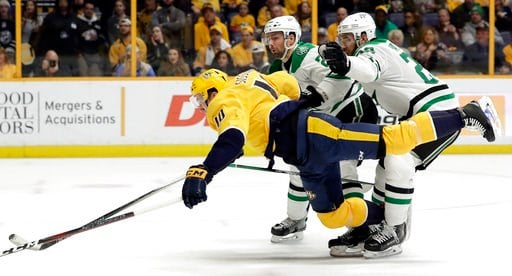 (AP Photo/Mark Humphrey). Dallas Stars defenseman Greg Pateryn, right takes down Nashville Predators center Colton Sissons (10) in the second period of an NHL hockey game Tuesday, March 6, 2018, in Nashville, Tenn. Pattern was penalized for holding.