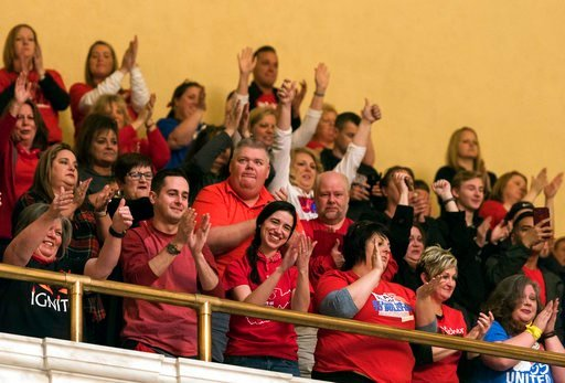 (Craig Hudson/Charleston Gazette-Mail via AP). Teachers and school personnel celebrate after the state Senate approved a bill to increase state workers pay across the board by 5 percent at the capitol in Charleston, W.Va., on Tuesday, March 6, 2018.