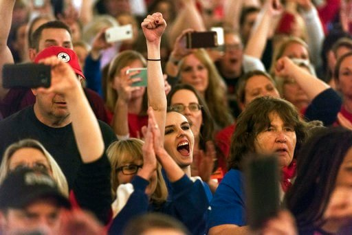 (Craig Hudson/Charleston Gazette-Mail via AP). Teachers and school personnel celebrate after the state Senate approved a bill to increase state employee pay by 5 percent at the capitol in Charleston, W.Va., on Tuesday, March 6, 2018.