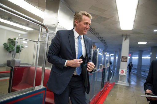 (AP Photo/J. Scott Applewhite). Sen. Jeff Flake, R-Ariz., arrives for a procedural vote as the Senate moves to pass legislation that would roll back some of the safeguards Congress put into place after a financial crisis rocked the nation's economy.