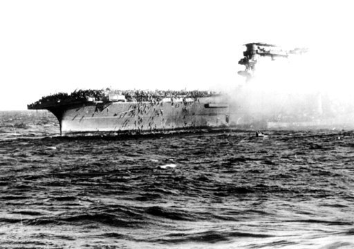 (U.S. Navy via AP). FILE - In this 1942 file photo, crew abandons the USS Lexington after the decks of the aircraft carrier sunk in the Battle of the Coral Sea during World War II. A piece of prized World War II U.S. naval history, the wreckage of the ...