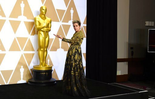"(Photo by Jordan Strauss/Invision/AP). Frances McDormand, winner of the award for best performance by an actress in a leading role for ""Three Billboards Outside Ebbing, Missouri"", poses in the press room at the Oscars on Sunday, March 4, 2018, at the D..."