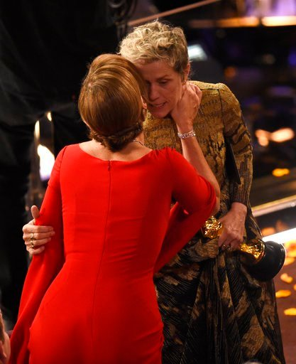 "(Photo by Chris Pizzello/Invision/AP). Allison Janney, left, congratulates Frances McDormand as she accepts the award for best performance by an actress in a leading role for ""Three Billboards Outside Ebbing, Missouri"" at the Oscars on Sunday, March 4,..."