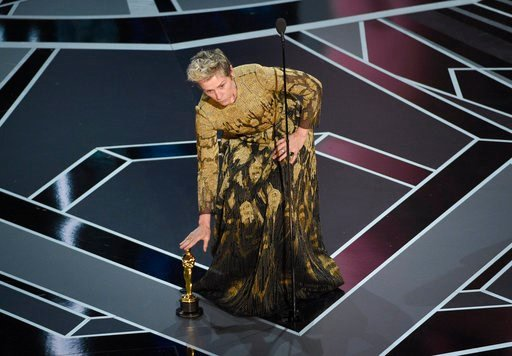 "(Photo by Chris Pizzello/Invision/AP). Frances McDormand places her award for best performance by an actress in a leading role for ""Three Billboards Outside Ebbing, Missouri"" on the stage at the Oscars on Sunday, March 4, 2018, at the Dolby Theatre in ..."