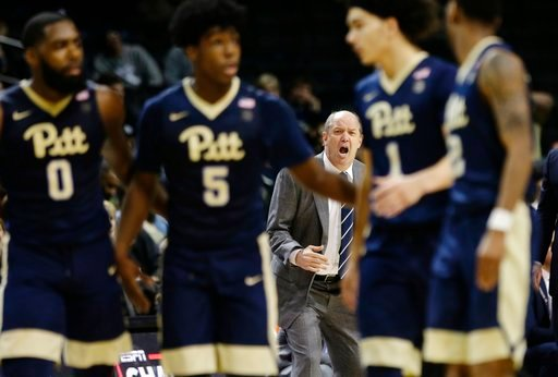 (AP Photo/Frank Franklin II). Pittsburgh head coach Kevin Stallings, rear, calls out to his players as Jared Wilson-Frame (0), Marcus Carr (5) and Parker Stewart (1) huddle with teammates during the second half of an NCAA college basketball game agains...