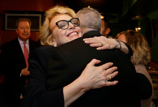 (Michael Wyke/Houston Chronicle via AP). Kathaleen Wall, Republican candidate to replace Ted Poe in Congress, hugs supporters at her watch party at the Adobe Cafe in Houston on Tuesday, March 6, 2018.