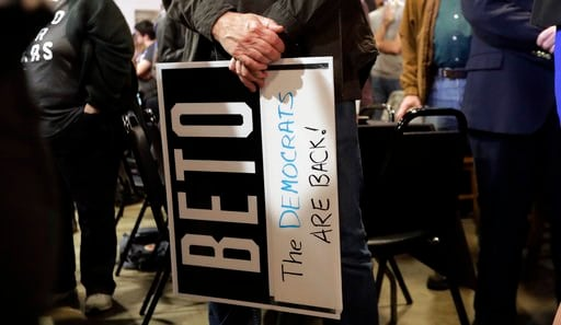 (AP Photo/Eric Gay). A supporter of senate hopeful Beto O'Rourke holds a sign during a Democratic watch party following the Texas primary election, Tuesday, March 6, 2018, in Austin, Texas.