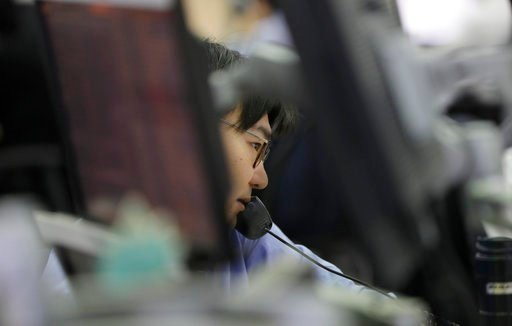 (AP Photo/Lee Jin-man). A currency trader talks on the phone at the foreign exchange dealing room in Seoul, South Korea, Wednesday, March 7, 2018. Asian stock markets fell Wednesday after the surprise departure of President Donald Trump's top economic ...