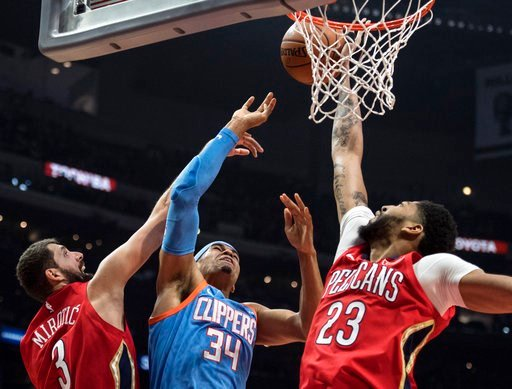 (AP Photo/Kyusung Gong). Los Angeles Clippers forward Tobias Harris has his shot blocked by New Orleans Pelicans forward Anthony Davis, right, during the second half of an NBA basketball game Tuesday, March 6, 2018, in Los Angeles.