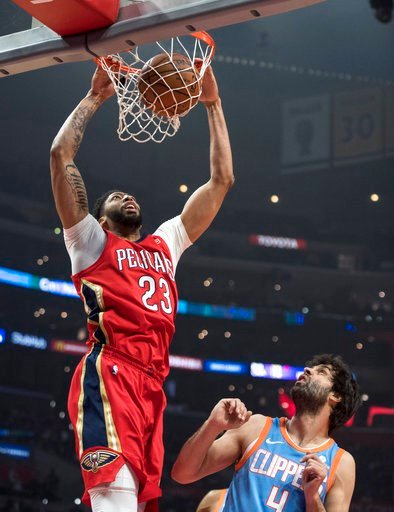 (AP Photo/Kyusung Gong). New Orleans Pelicans forward Anthony Davis, left, dunks as Los Angeles Clippers guard Milos Teodosic looks on during the first half of an NBA basketball game Tuesday, March 6, 2018, in Los Angeles.
