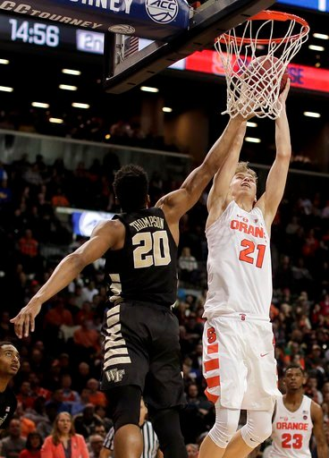 (AP Photo/Julie Jacobson). Syracuse forward Marek Dolezaj (21) shoots against Wake Forest forward Terrence Thompson (20) during the second half of an NCAA college basketball game in the Atlantic Coast Conference men's tournament Tuesday, March 6, 2018,...
