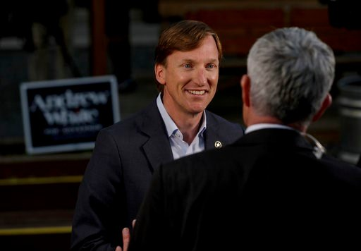 (Jon Shapley/Houston Chronicle via AP). Andrew White, front left, a Democratic candidate for governor, talks to a television reporter before an election watch party at Raven Tower in Houston on Tuesday, March 6, 2018.