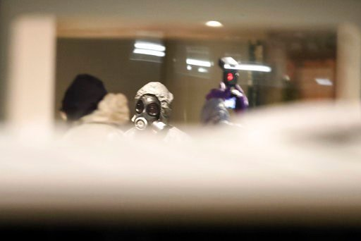 (Steve Parsons/PA via AP). Investigators inside the Zizzi restaurant in Salisbury, England, Tuesday, March 6, 2018 near to where former Russian double agent Sergei Skripal was found critically ill.  Britain's counterterrorism police took over an invest...
