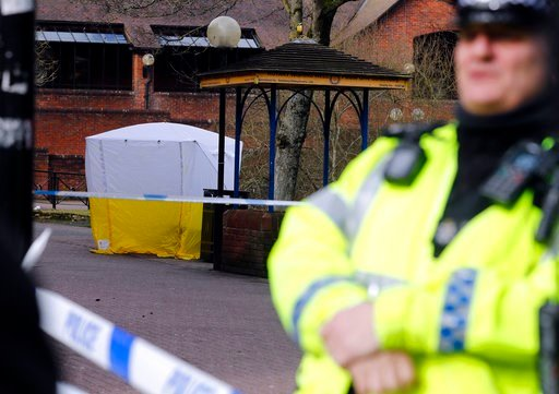 (AP Photo/Frank Augstein). Police officer secures the area as a police tent covers the the spot in Salisbury, England, Tuesday, March 6, 2018, where former Russian spy double agent Sergei Skripal and his companion were found critically ill Sunday follo...