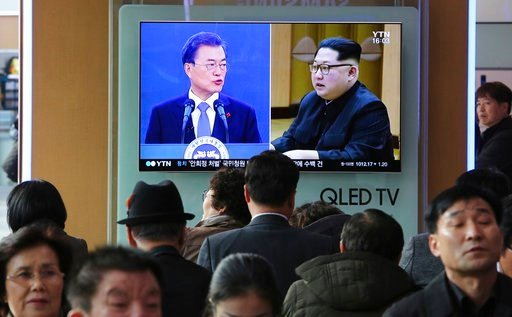(AP Photo/Ahn Young-joon). People watch a TV screen showing images of North Korean leader Kim Jong Un and South Korean President Moon Jae-in, left, at the Seoul Railway Station in Seoul, South Korea, Wednesday, March 7, 2018. After years of refusal, No...