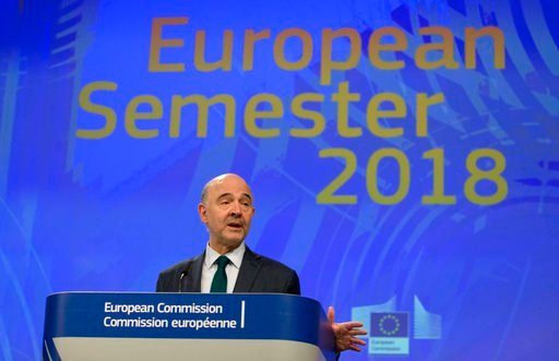 (AP Photo/Virginia Mayo). European Commissioner for Economic and Financial Affairs Pierre Moscovici speaks during a media conference at EU headquarters in Brussels on Wednesday, March 7, 2018. The European Commission on Wednesday published its annual a...