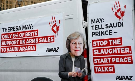(AP Photo/Alastair Grant). A protester wears a mask of Britain's Prime Minister Theresa May outside the Palace of Westminster in London, Wednesday, March 7, 2018, to demonstrate against Britain's role as an arms supplier to Saudi Arabia, and to protest...