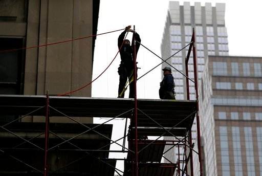 (AP Photo/Seth Wenig, File). FILE- In this Feb. 20, 2018, file photo, construction workers work in midtown Manhattan in New York. On Wednesday, March 7, the Labor Department issues revised data on productivity in the four quarter.