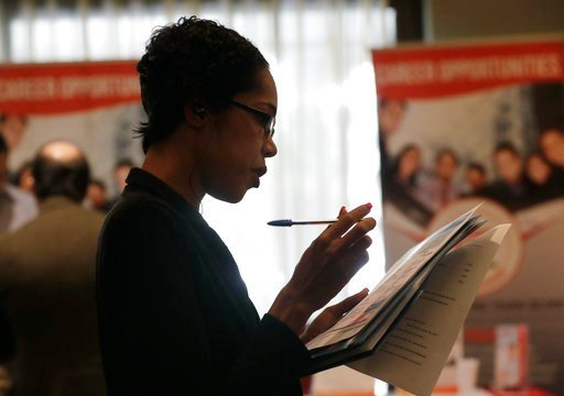 (AP Photo/Lynne Sladky). In this Tuesday, Jan. 30, 2018, photo, Joana Dudley, of Lauderhill, Fla., looks at her list of job prospects at a JobNewsUSA job fair in Miami Lakes, Fla. On Wednesday, March 7, 2018, payroll processor ADP reports how many jobs...