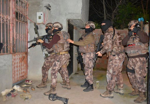 (Gokhan Keskinci/DHA-Depo Photos via AP). Turkey's special police officers prepare to storm a house during an operation to arrest Islamic State group suspects, in the southern city of Adana, Turkey, early Wednesday, March 7, 2018. Turkey's state-run ne...