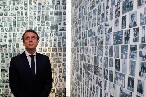 (Philippe Wojazer/Pool Photo via AP, File). FILE - In this Sunday, April 30, 2017 file picture, independent centrist presidential candidate Emmanuel Macron looks at some of the 2,500 photographs of young Jews deported from France, during a visit to the...