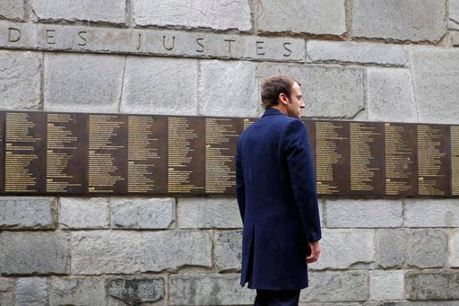 "(Philippe Wojazer/Pool Photo via AP, File). FILE - In this Sunday, April 30, 2017 file picture, independent centrist presidential candidate Emmanuel Macron stands at the ""Mur des Justes"" at the Shoah Museum, a wall on which 2,693 names of people who pr..."