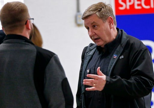 (AP Photo/Keith Srakocic). In this March 5, 2018, photo, Republican Rick Saccone, right, talks with supporters at a campaign rally in Waynesburg, Pa. Saccone is running against Democrat Conor Lamb in a special election being held on March 13 for the PA...