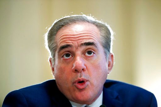 (AP Photo/Jacquelyn Martin). In this Feb. 15, 2018 photo, Veterans Affairs Secretary David Shulkin speaks during a hearing on the FY19 budget to the House Veterans Affairs Committee, on Capitol Hill in Washington.