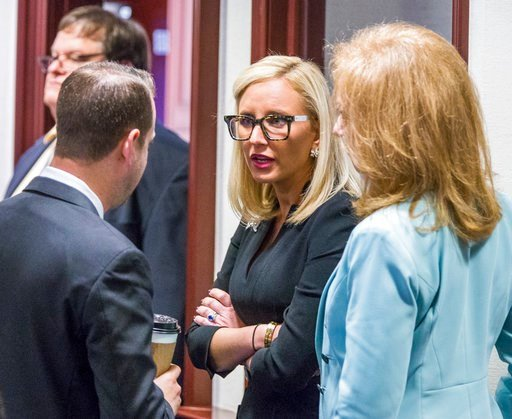 (AP Photo/Mark Wallheiser). Florida Sen. Lauren Book (D-Plantation), center, speaks with Rep. Jared Even Moskowitz (D-Coral Springs), left, and Rep. Kristin Diane Jacobs (D-Coconut Creek) on the House floor during questioning on the school safety bill ...