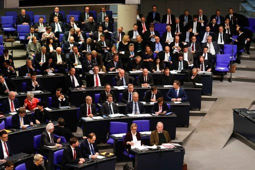 (AP Photo/Markus Schreiber,fls). FILE - In this Dec. 12, 2017 file photo lawmakers of the Alternative for Germany, AfD, attend a debate at the German parliament Bundestag in Berlin. Germany's domestic intelligence agencies are discussing what steps mig...