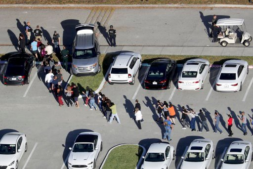 (Mike Stocker/South Florida Sun-Sentinel via AP, File). FILE - In this Feb. 14, 2018, file photo, students are evacuated by police from Marjory Stoneman Douglas High School in Parkland, Fla., after a shooter opened fire on the campus. Modern technology...